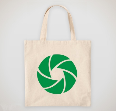 Frame Your Story logo mark printed on a canvas tote bag