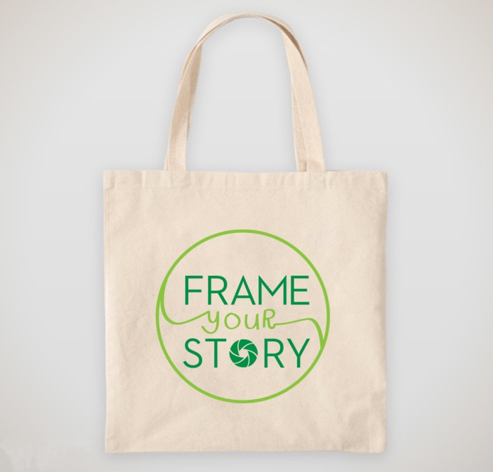 Frame Your Story logo printed on a canvas tote