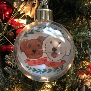 Holiday ornament with an illustrated portrait of two dogs named Bean and Rudy