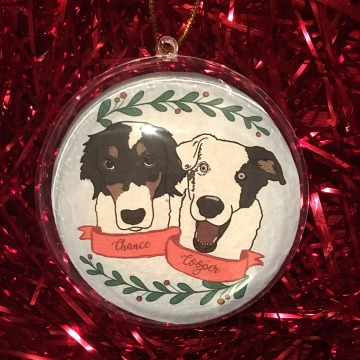 Holiday ornament with an illustrated portrait of two dogs named Chance and Cooper
