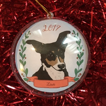 Holiday ornament with an illustrated portrait of a dog named Lena