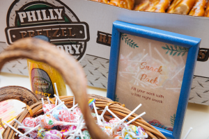 Framed sign that reads Snack Pack. Fill your snack with a late night snack.