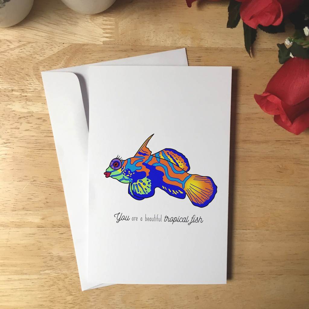Greeting Card design with an illustration of a tropical fish that has red lipstick and eyelashes. The text reads You are a beautiful tropical fish.
