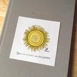 Sticker design with an illustrated sun. The text reads You are the most beautiful, glowing sun goddess.