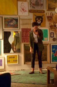 Comedian Rachel Peters performing in Como se Dice