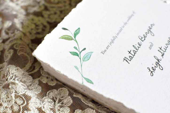Stack of Wedding Invitations. Detail of watercolor leaves.