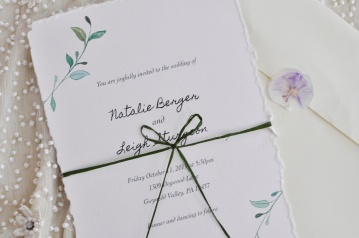 Wedding Invitation with green ribbon.