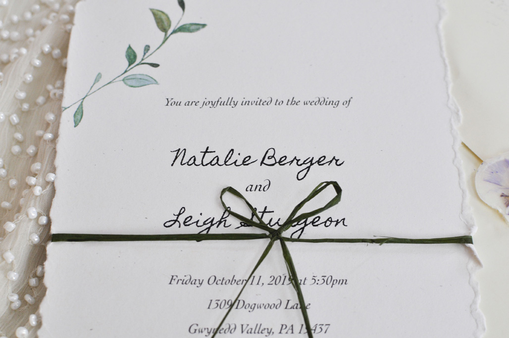 Wedding Invitation with green ribbon (close up)