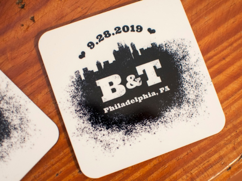 A coaster with a spray paint design that features the Philadelphia skyline and reads 9.28.2019 B&T Philadelphia, PA