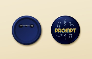 Branded merchandise for Prompt. A pin with the word Prompt surrounded by arrows.