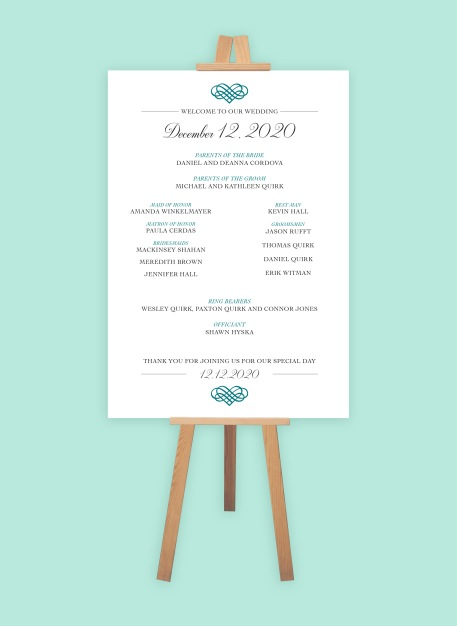 Large format poster on a wooden easel with the wedding date and names of the bridal party.